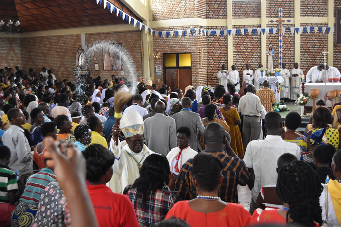 Bishop Célestin Hakizimana blessing the congregation with holy water during the mass of the Solemnity of Our Lady of Sorrows.